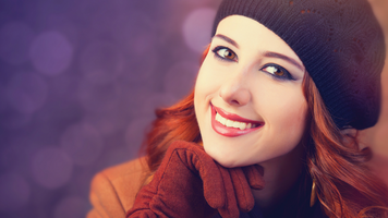 """Woman with soft focus """"bokeh"""" lights in background"""