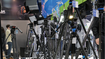 Photo of a collection of various tripods