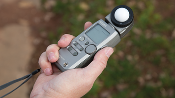 Photo of someone holding a light meter