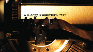 "Old fashioned typewriter with ""A Sleepy Midwestern Town"" on paper"