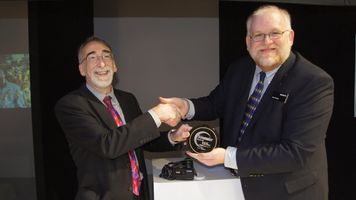 Videomaker's Matt York awards Sony with a plaque for best camcorder of CES 2013