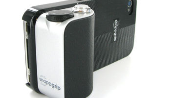 mobile phone with a white attachment to look like a compact camera