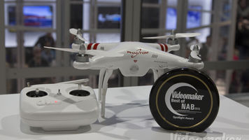 Phantom quadcopter next to a remote control and award