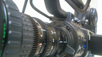 Closeup shot of a long camcorder telephoto lens