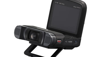 Compact camera with flip up screen and stand