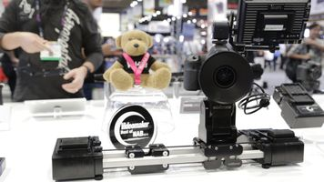 Camera on a slider with attachments and an award