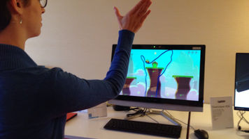 Woman with hand raised and outline of her hand on computer monitor