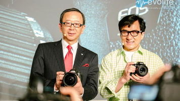 Canon China President & CEO Hideki Ozawa and action legend Jackie Chan show off what appears to be a new 4K camera from Canon