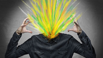 Man's head replaced by burst of color symbolic of creativity