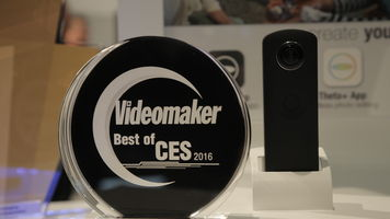 The Ricoh Theta S next to Videomaker's Best of CES 2016 award trophy