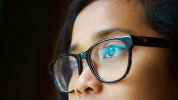 woman wearing glaring glasses