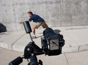 """Camera mounted on its side to record """"man climbing wall"""" effect."""