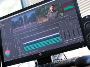 Premiere Creative Cloud User Interface on an HP Monitor