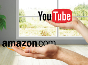 one hand with the amazon.com logo in it, a second hand holding the youtube logo