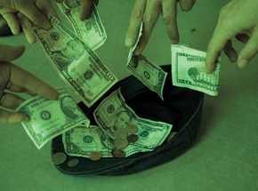 Photo showing multiple hands tossing money into a hat.