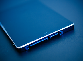 SSD disk drive in blue technological background