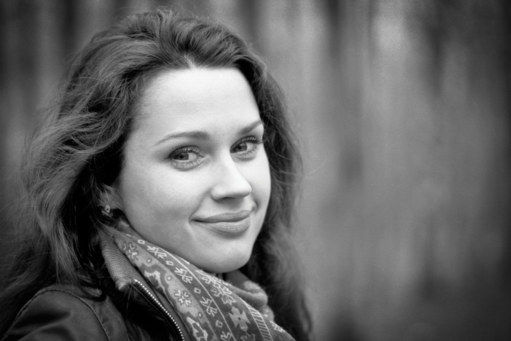 Photo in black and white of a woman with soft focus background