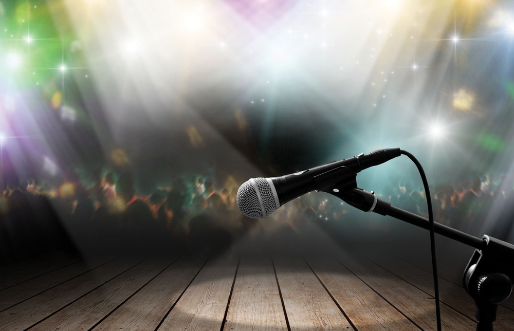 Photo of a solitary microphone on a stage