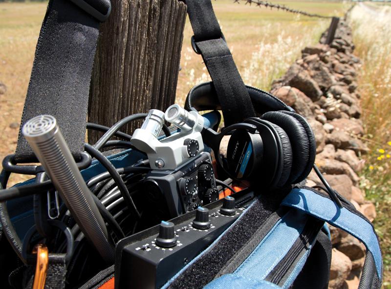 Audio gear along a rock fence