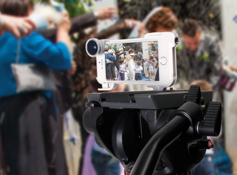 Shot of an iPhone in a tripod with a nice lens attachment, showing a scene at a wedding.