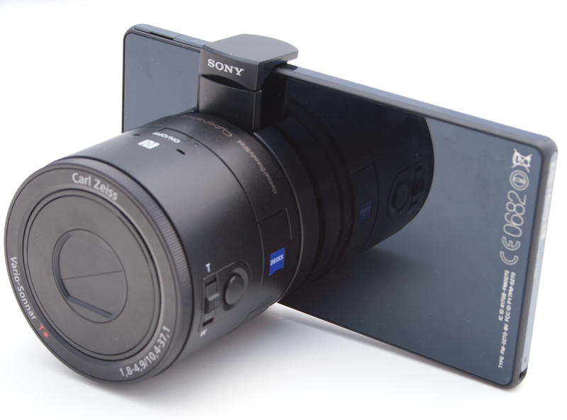 The Sony QX100 Lens Cam attached to a smartphone.