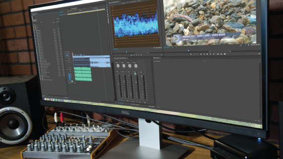 Editing station with Adobe Premiere on monitor.