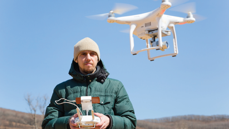 Person flying a drone.