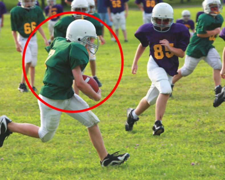 boy-football-player-running-on-field