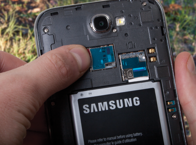 Closeup shot of a memory card being removed from the back of a Samsung Android phone.