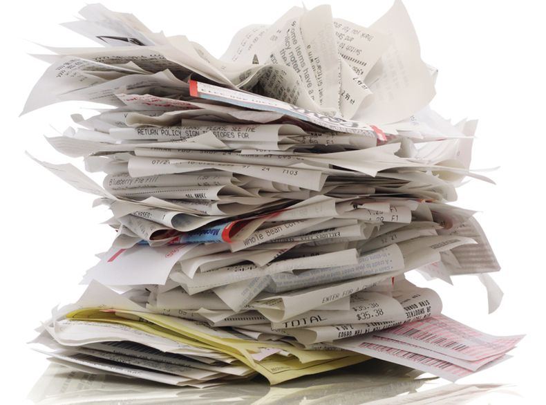 Image of a lot of receipts piled up.