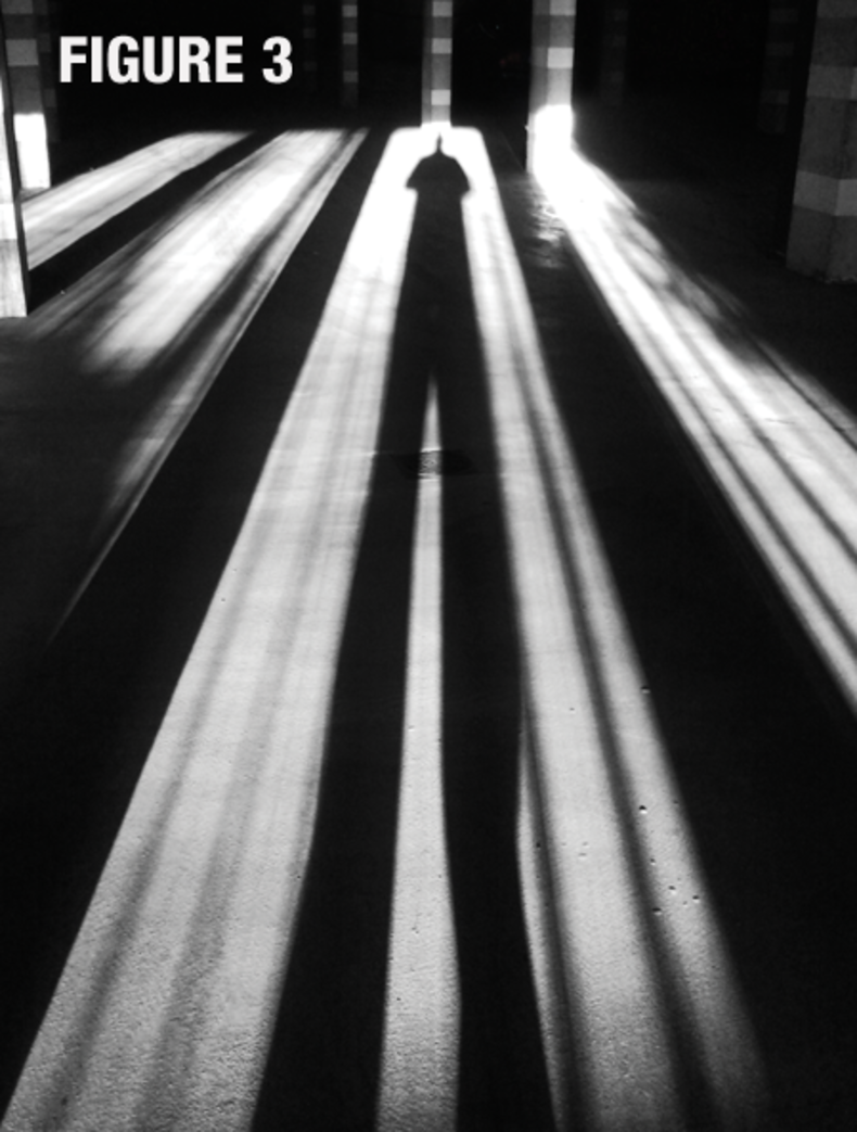 Black and white photo of the long shadow cast by a person across a floor labeled & How to Light a Horror Scene | Videomaker.com azcodes.com