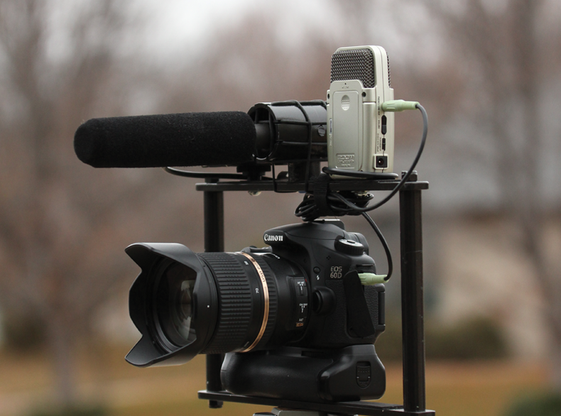 A Canon EOS 60D camera on a rig with a Zoom recorder and a shotgun mic