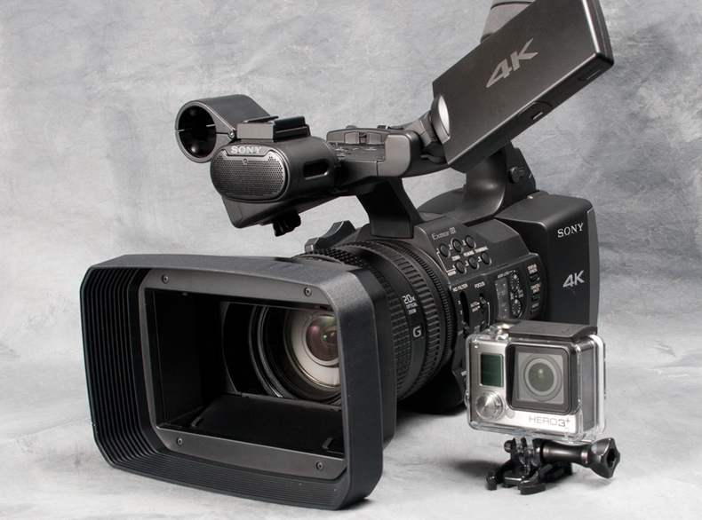 Side-by-side shots of the Sony FDR-AX1 and the GoPro HERO3+.