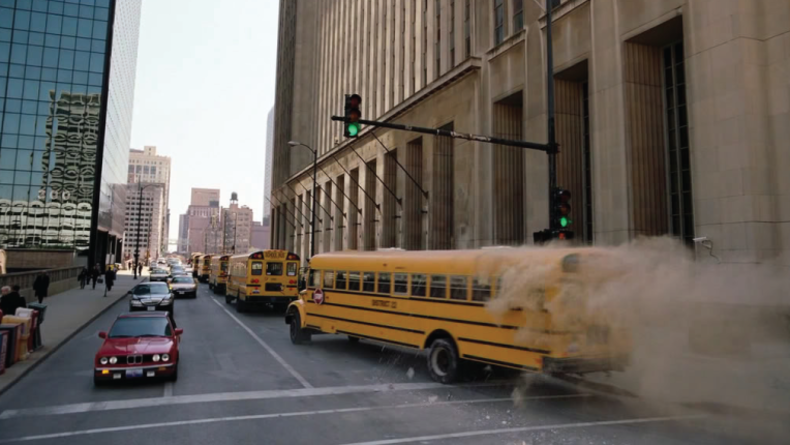 Scene from the Dark Knight - school bus full of gangsters in line of school buses.