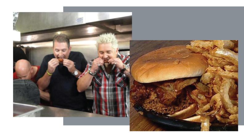 Guy tasting hot wings and a hamburger dish