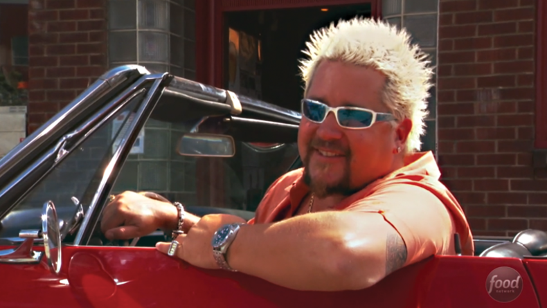 Guy in his signature red convertable.