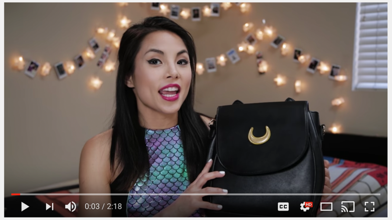 Anna Akana doesn't use title cards, but she typically introduces the gist of the video within 5 seconds