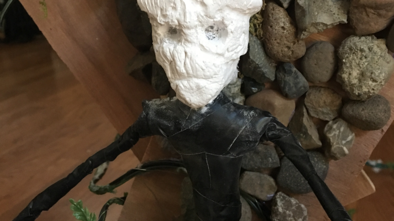 Puppet's head placed on wire armature