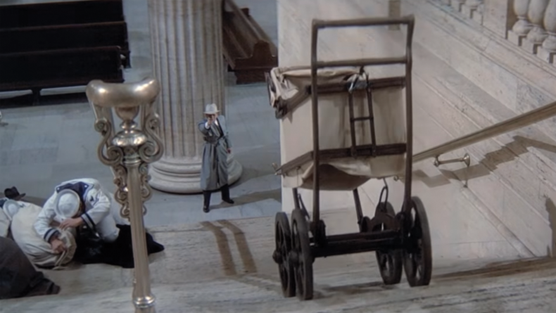 Baby carriage traveling down the stairs, right into the path of gun fire.