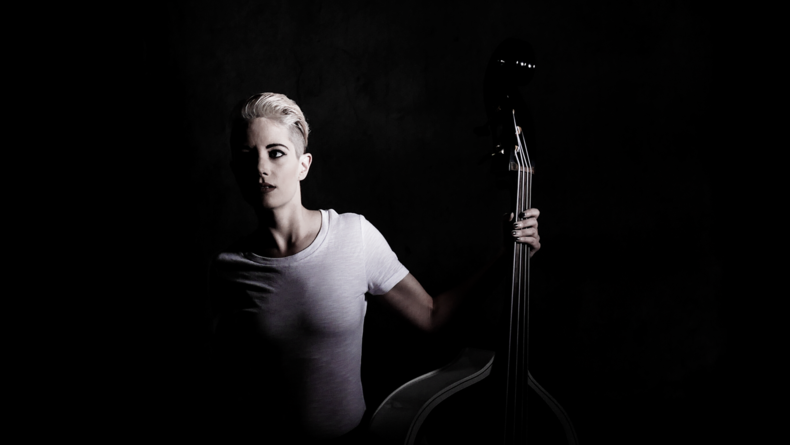 Crop from a portrait of bass player Eliza Rector that uses hard light. I lit this image with a small light positioned across the room that I snooted to make it even harder.