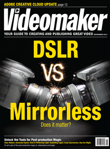 Videomaker November 2014 cover showing a DSLR and a Mirrorless camera crashing into each other. Titled DSLR vs Mirrorless Does it Matter?