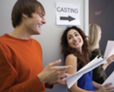 People with scripts standing in a casting call line