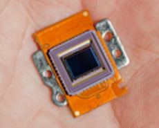 Photo of an image sensor in the palm of a hand