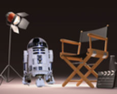Director's chair and robot form Star Wars, R2-D2, with single video spotlight