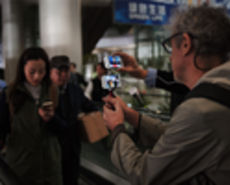 A cinematographer shoots a scene with one iPhone 5s and uses another to allow the director to oversee the action remotely with FaceTime.