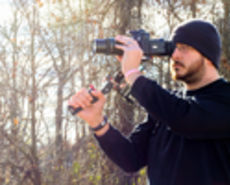 Man with camera and support gear