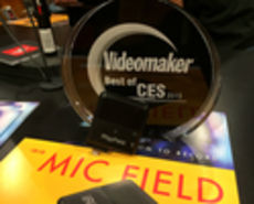 Small square mic in front of an award