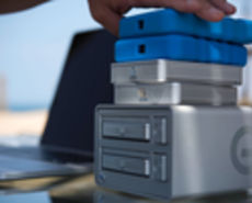 Stack of hard drives with blue ones on top