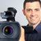 Photo of a smiling man holding a camcorder