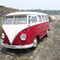 Toy VW bus on rocks.